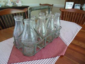 This set of milk bottles and carrier was found at the Brimfield Flea Market, another source of home decoration items.