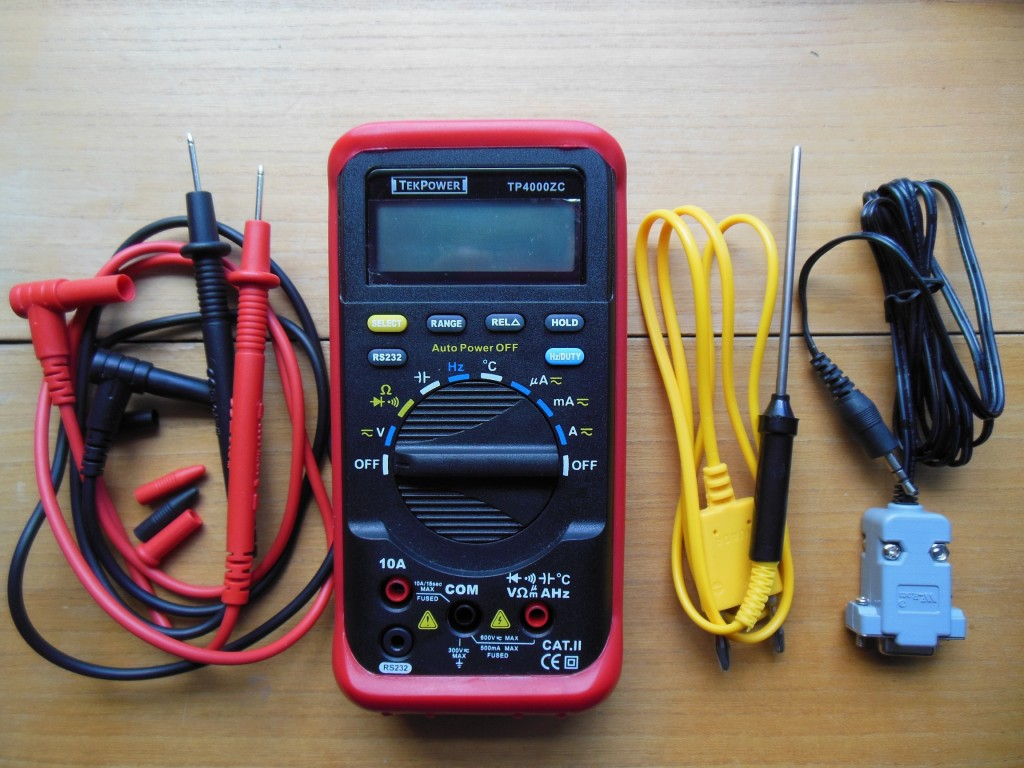 The TekPower model TP4000ZC is one amazing little digital multimeter. From left to right: probes, meter, thermometer probe, RS232 computer interface cable. It also comes with a mini-CD containing software and drivers.