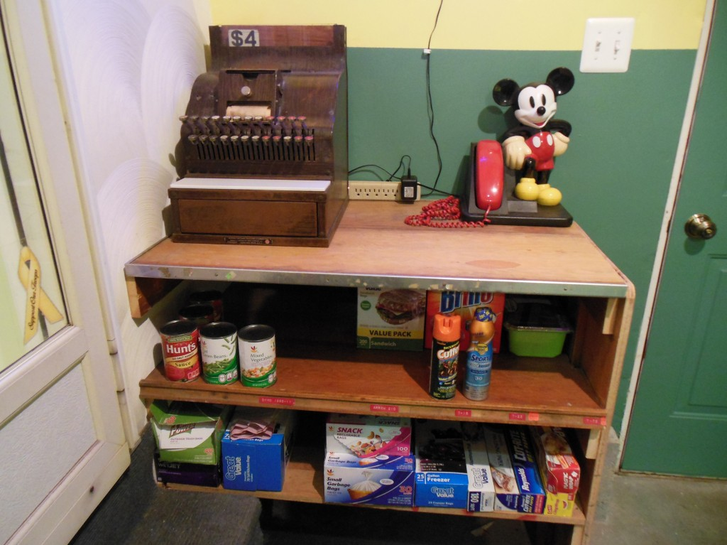 This is what grocery and hardware store shelving looked like when I was a kid back in the '50's (except the Mickey Mouse telephone).