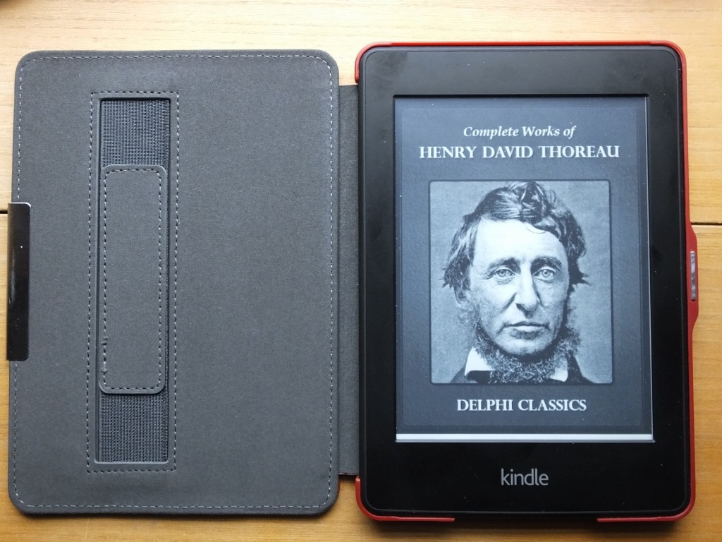 The Kindle Paperwhite showing cover page of Henry David Thoreau book compiled by Delphi Classics.
