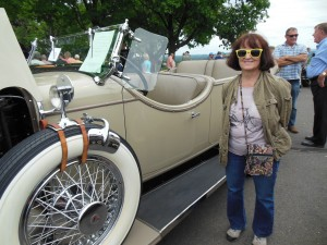 My wife sports a smile next to the Stutz.