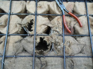 Each spring is wrapped in burlap and sewn shut. This does not deter mice, as you can easily see. Long nose pliers and tongs are effective at pulling out the mess that a vacuum can't get to.