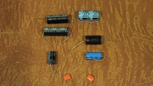 The parts include at least 50 unused electrolytic capacitors, all having a rating of 450 volts. That's plenty adequate for most old radio applications. I tested several and they were all good.