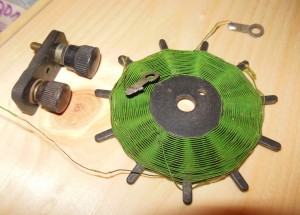 These parts date back to the early days of radio, the 1920's. Binding posts are on the left. The spider coil would be attached to a shaft and knob and rotate within another coil.