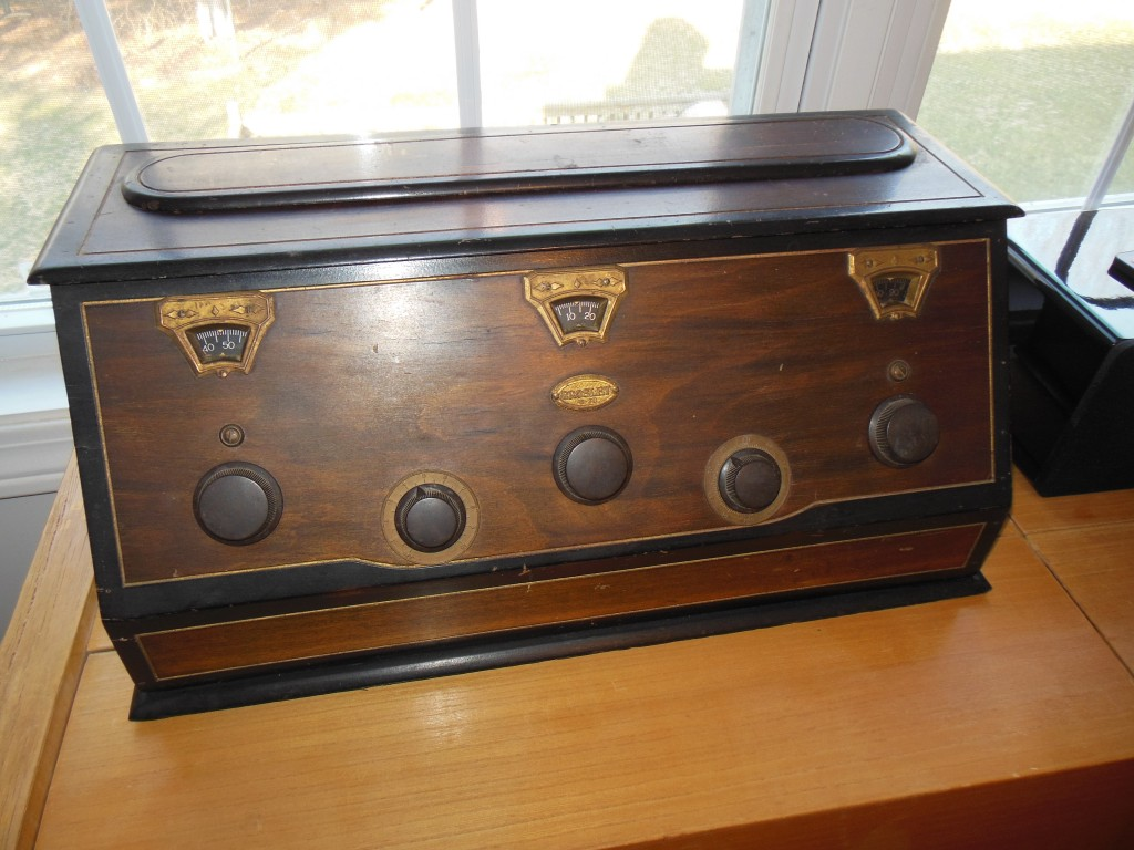 This is the Crosley model 5-38. Five tubes and $38. Crosley was known for making radios affordable for everyone. Maybe a little cleaning, Old English and lemon oil will be enough to make hide the scratches.