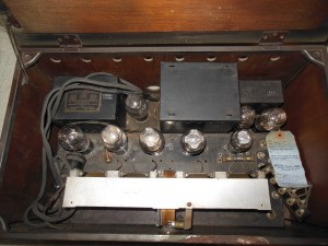 It looks like three sets of transformers in the back. The no. 80 rectifier tube is seen to the back left. This radio was made at the time of the transition from battery to mains for powering home radios.