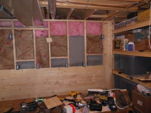 The back wall was slightly over 8 feet long so I had to put one vertical board at the end. It abuts the storage racks.