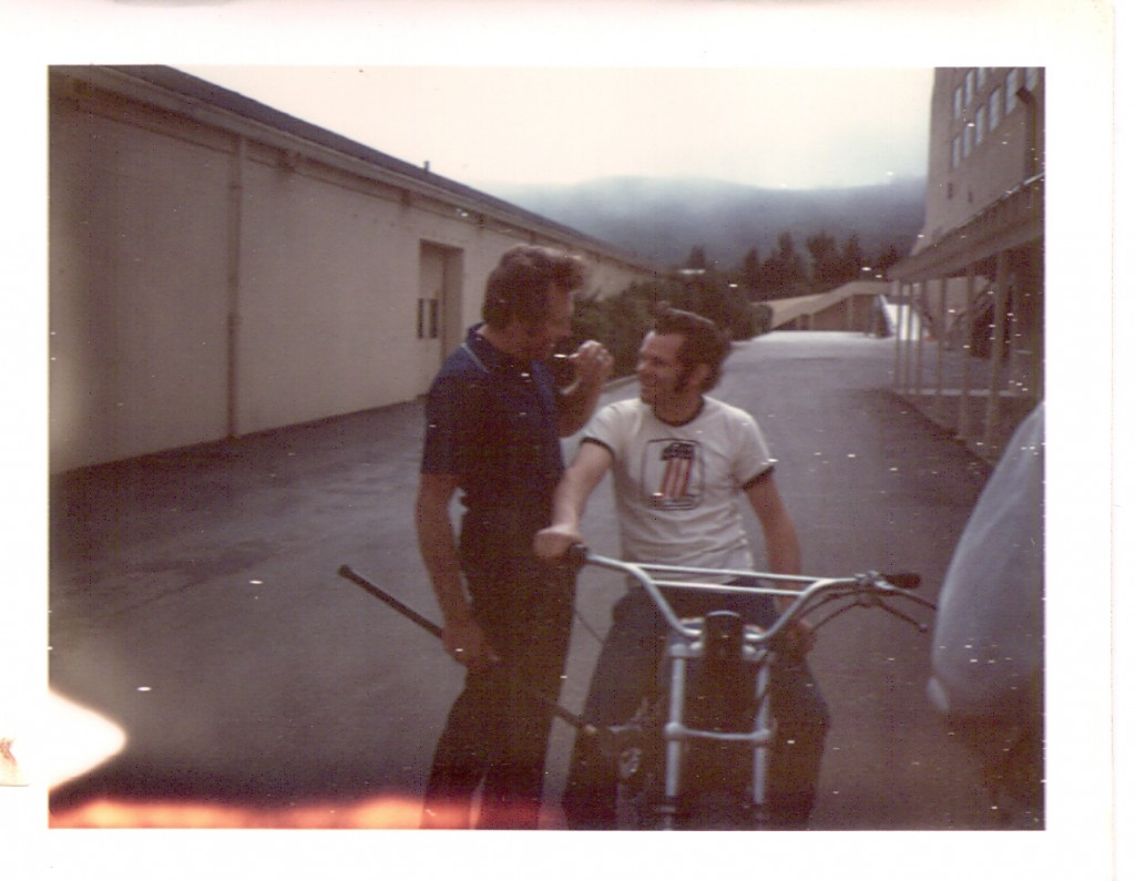Evel enjoying a light moment with Flat Track ace Roger Reiman (on the bike). They are at the Cow Palace in San Francisco, CA.