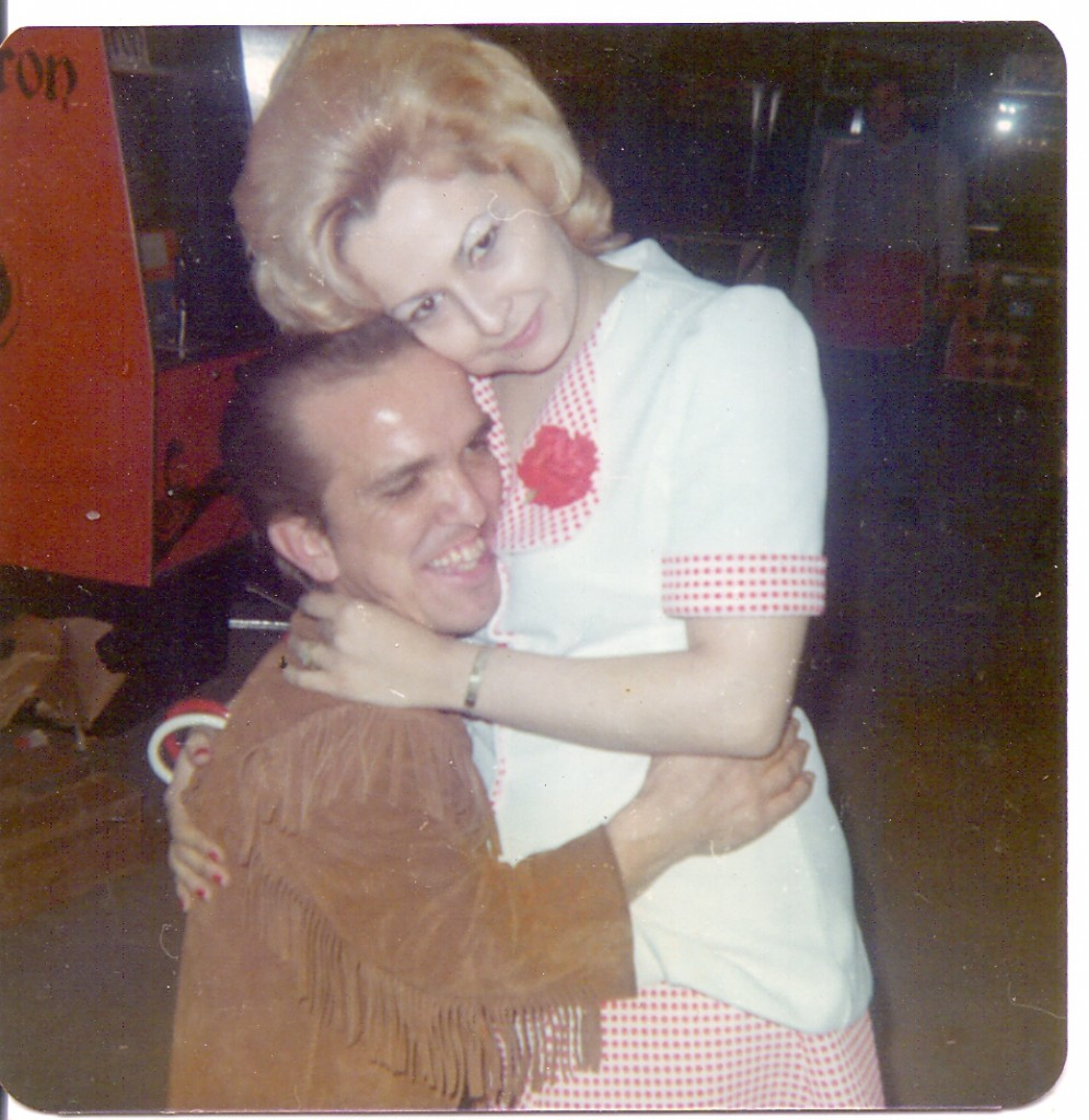 Butch with a young lady who was a groupie of the Evel Knievel Show. She posed with several of the guys.